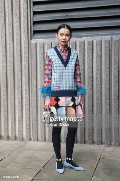 Fashion buyer Sherry Shen wears a Prada jumper and shirt on day 1 of London Collections Men on June 9 2017 in Paris France