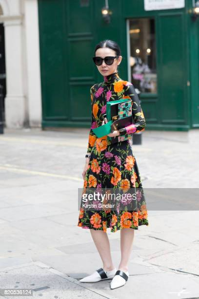 Fashion buyer Sherry Shen wears Marni shoes Prada bag Celine sunglasses and a Balenciaga dress on day 3 of London Collections Men on June 11 2017 in...
