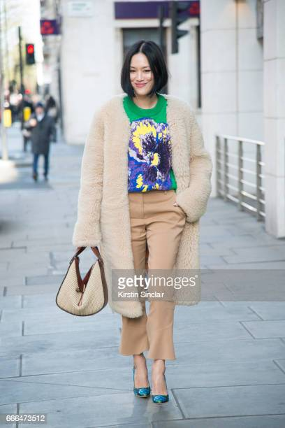 Fashion buyer Tiffany Hsu wears a Christopher Kane top and jacket Miu Miu shoes and a Loewe bag on day 4 of London Womens Fashion Week Autumn/Winter...