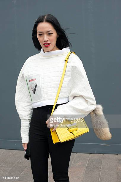 Fashion buyer Tiffany Hsu wears a JWAnderson top Rodarte jeans and Loewe bag on day 3 during London Fashion Week Autumn/Winter 2016/17 on February 21...