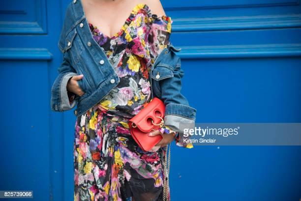 Fashion buyer Tiffany Hsu wears a Preen dress Balenciaga jacket and JW Anderson bag day 1 of Paris Haute Couture Fashion Week Autumn/Winter 2017 on...