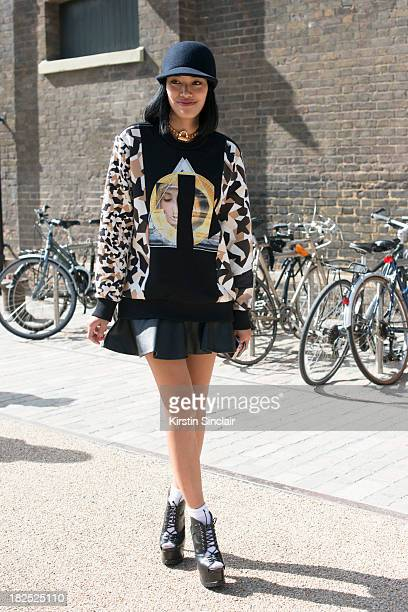 Fashion buyer Tiffany Hsu wears Mawi necklace Stella McCartney hat Givenchy dress and Alaia shoes on day 4 of London Fashion Week Spring/Summer 2013...