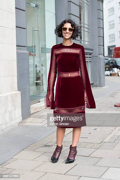 Fashion buyer Yasmin Sewell wears a Christopher Kane dress, Kenzo boots and vintage sun glasses on day 4 of London Fashion Week Spring/Summer 2013,...