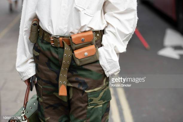 Fashion Buying Director at Mytheresa Tiffany Hsu wears a JW Anderson belt vintage military trousers and an Ader Error shirt during London Fashion...