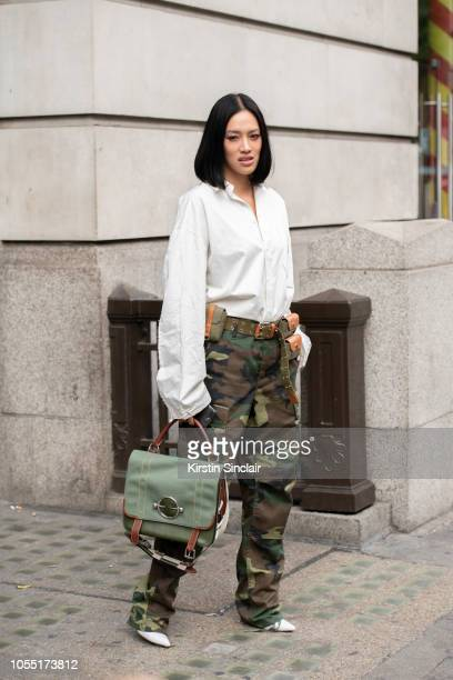 Fashion Buying Director at Mytheresa Tiffany Hsu wears a JW Anderson bag and belt Ader Error shirt and vintage trousers during London Fashion Week...