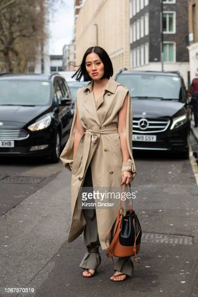 Fashion Buying director for My Theresa Tiffany Hsu wears a JW Anderson coat, Christopher Esber trousers, Loewe bag and Bottega Veneta shoes during...
