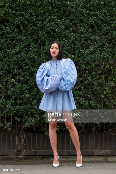 Fashion buying director for Mytheresa Tiffany Hsu wears a Loewe dress and Amina Muaddi shoes as part of Paris Fashion Week on March 07, 2021 in...