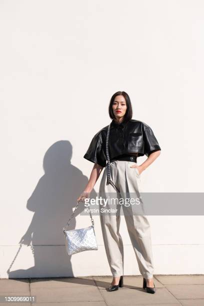 Fashion buying director for Mytheresa Tiffany Hsu wears all Louis Vuitton as part of Paris Fashion Week on March 10, 2021 in London, England.