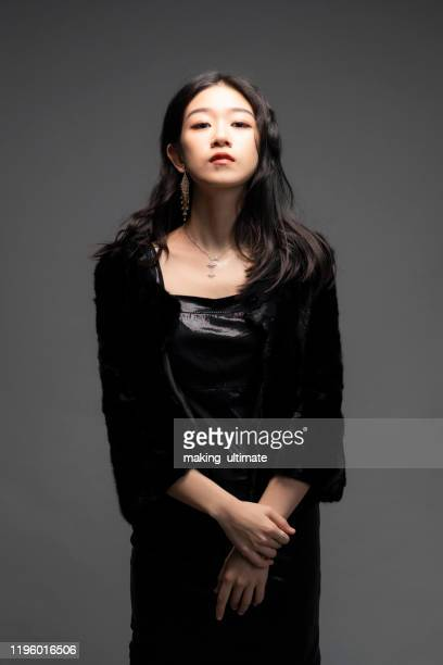 a fashion chinese beauty in a studio - fine art portrait stock pictures, royalty-free photos & images