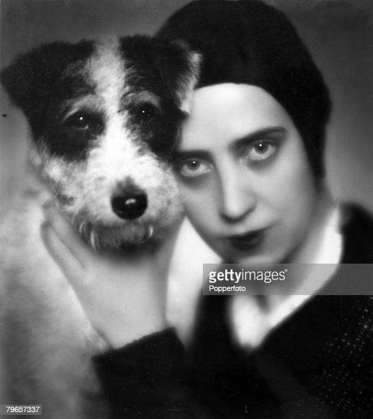Fashion Circa 1920's Designer Elsa Schiaparelli with a dog