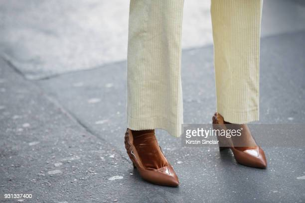 Fashion consultant and blogger Chloé Harrouche of Loulou De Saison wears Diane Ducasse trousers and Céline shoes day 2 of Paris Womens Fashion Week...