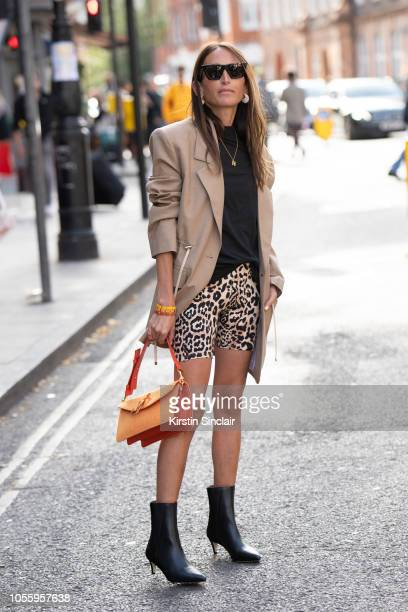 Fashion Consultant and digital influencer Chloé Harrouche of Loulou De Saison wears a Tibi jacket JW Anderson bag Paco Rabanne shorts ATP Atelier...