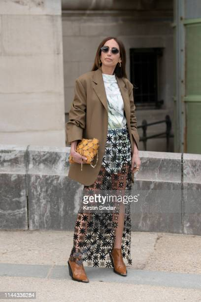 Fashion Consultant and digital Influencer Chloe Harrouche of Loulou de Saison wears a Paco Rabanne skirt, top, shoes and bag and a Celine jacket on...