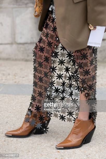 Fashion Consultant and digital Influencer Chloe Harrouche of Loulou de Saison wears a Paco Rabanne skirt and boots with a Celine jacket on February...