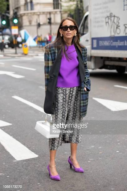Fashion Consultant Chloé Harrouche of Loulou De Saison wears Celine sunglasses and earrings Regina Pyo bag Tibi jacket sweater and shoes Alexa Chung...