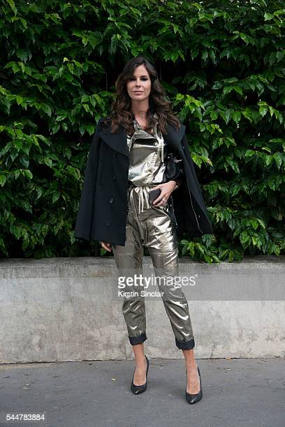 Fashion Consultant Christina Pitanguy wears a Isabel Marant overall Rochas blazer Fendi bag and Saint Laurent shoes on day 1 of Paris Haute Couture...