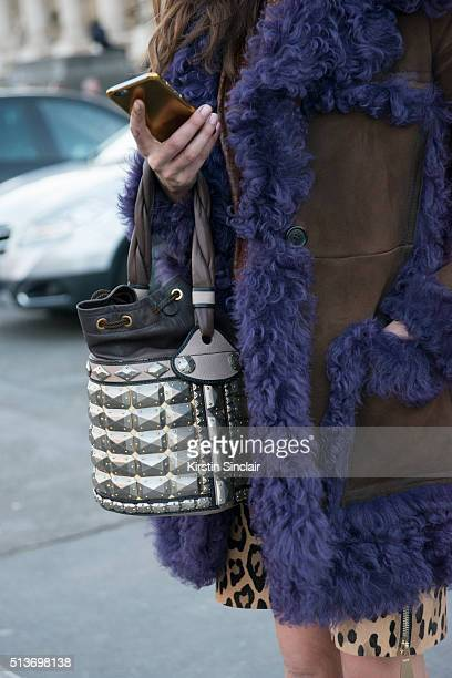 Fashion Consultant Ece Sukan wears Prada coat Fendi bag on day 3 during Paris Fashion Week Autumn/Winter 2016/17 on March 3 2016 in Paris France