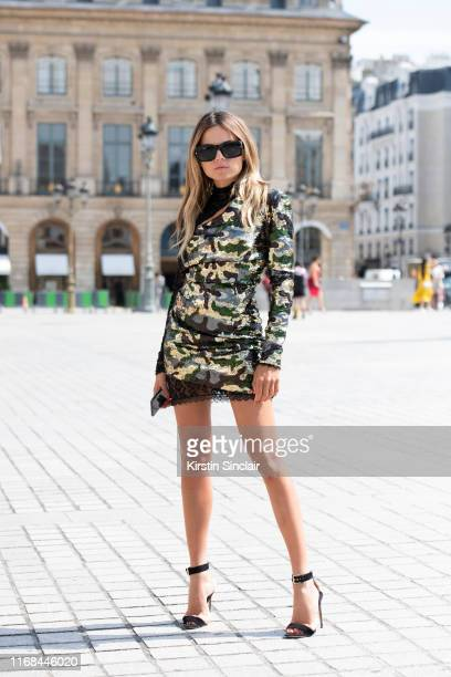 Fashion consultant Erica Pelosini Leeman wears a Peter Dundas dress, Tom Ford sunglasses and Brian Attwood shoes on July 01, 2019 in Paris, France.