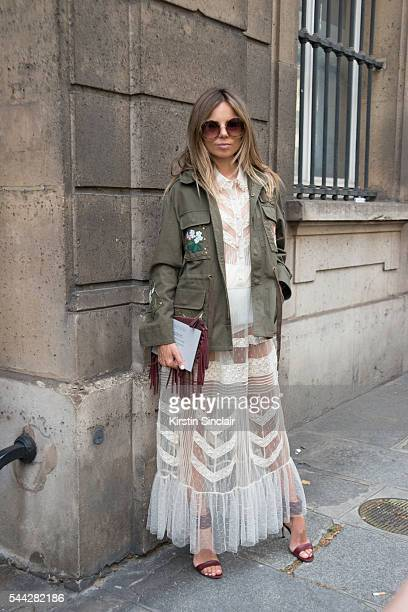 Fashion Consultant Erica Pelosini wears a Valentino dress Gianvito Rossi shoes and Chloe sunglasses on day 1 of Paris Collections Men on June 22 2016...