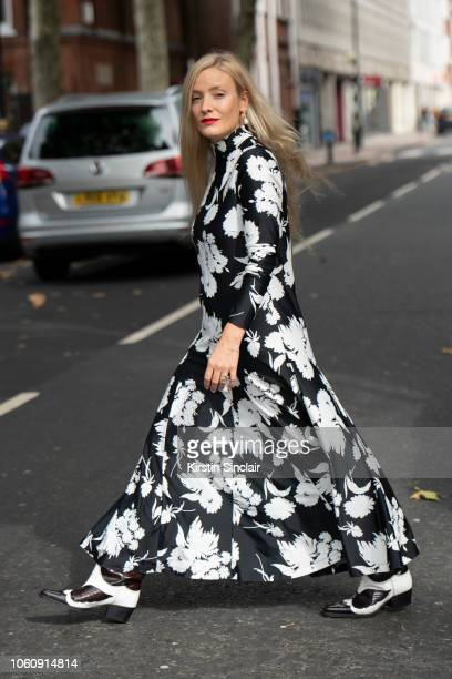 Fashion Consultant Kate Foley wears a Ganni dress and boots during London Fashion Week September 2018 on September 16 2018 in London England