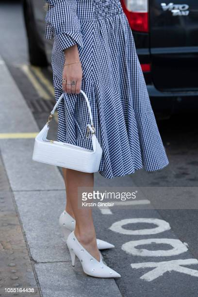 Fashion Consultant Kate Foley wears an Eudon Choi dress Celine shoes and Rejina Pyo bag during London Fashion Week September 2018 on September 15...