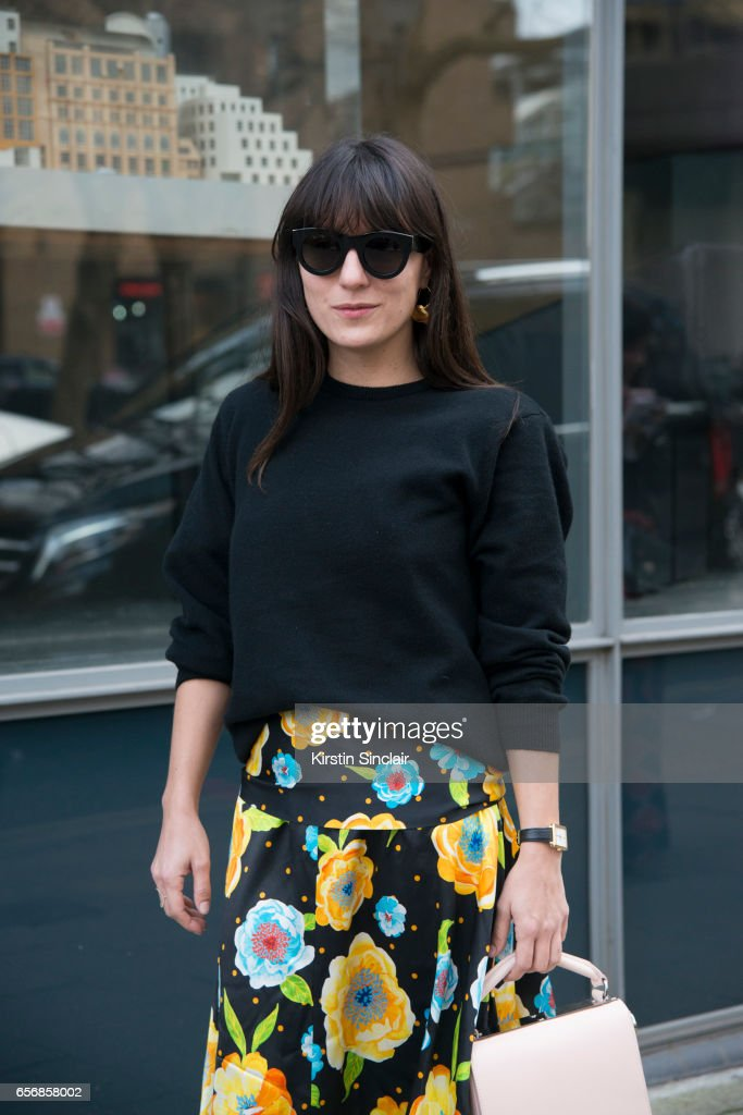 Fashion consultant Katherine Ormerod wears Celine sunglasses, Sophie Hulme bag, Johnston's of Elgin top and a Top Shop skirt on day 3 of London Womens Fashion Week Autumn/Winter 2017, on February 19, 2017 in London, England.