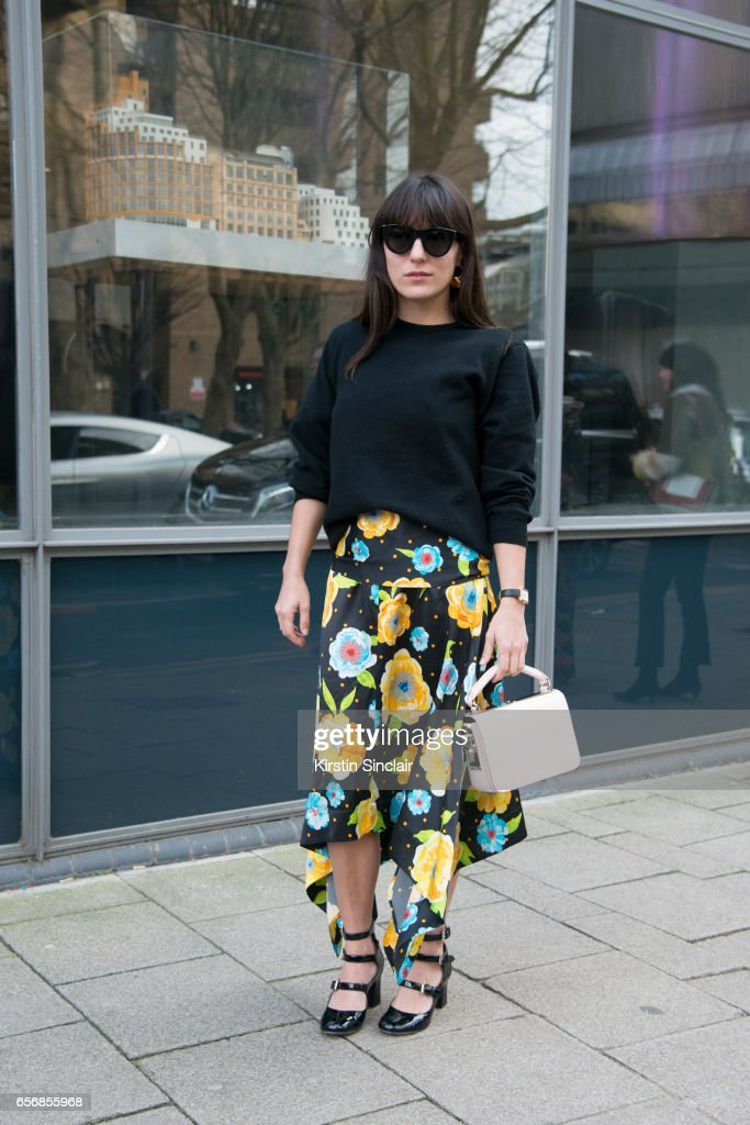 Fashion consultant Katherine Ormerod wears Celine sunglasses, Tabitha Simmons shoes, Sophie Hulme bag, Johnston's of Elgin top and a Top Shop skirt on day 3 of London Womens Fashion Week Autumn/Winter 2017, on February 19, 2017 in London, England.