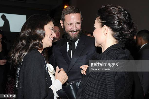 Fashion consultant Katherine Ross, Ermenegildo Zegna head of design Stefano Pilati, and Rosetta Getty attend the Ermenegildo Zegna Eminences Grises...