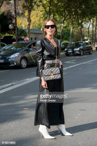Fashion consultant Loulou de Saison wears a Dior Vintage dress Dior top and bag Celine sunglasses and boots and All blues earrings day 1 of Paris...
