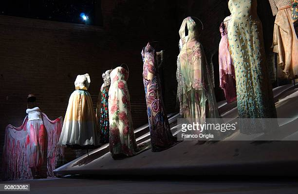 Fashion creations are displayed at a retrospective exhibition of Italian designer Giorgio Armani's work at the Baths of Diocletiano on May 5 2004 in...