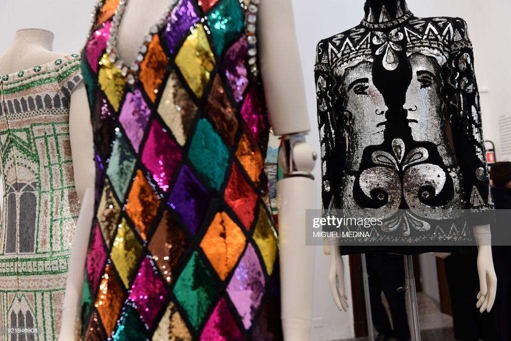 Fashion creations are on display during the exhibition 'Italiana, Italy Through the Lens of Fashion' at Palazzo Reale in Milan, on February 21, 2018. / AFP PHOTO / Miguel MEDINA / RESTRICTED
