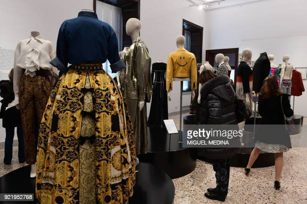 Fashion creations are on display during the exhibition Italiana Italy Through the Lens of Fashion at Palazzo Reale in Milan on February 21 2018 / AFP...
