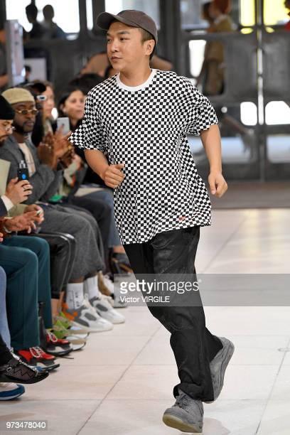 Fashion deisgner Xander Zhou walks the runway at the Xander Zhou Spring/Summer 2019 fashion show during London Fashion Week Men's June 2018 on June...