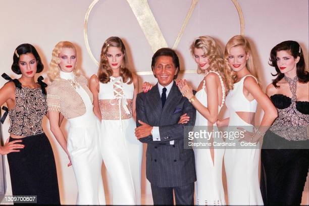 Fashion desgner Valentino pose backstage with models Naja Auermann , Claudia Schiffer 3rd R), Karen Mulder and Stephanie Seymour during the Valentino...