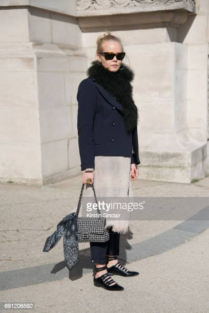 Fashion design student Amanda Bugge wears a Chanel bag Céline sunglasses Topshop shoes Luxuri scarf H and M jacket on day 3 during Paris Fashion Week...