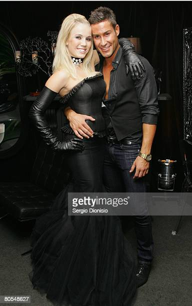 Fashion designer Adam Williams poses with model Amy Deckwick during the Drambuie Penthouse cocktail party on the Rooftop on April 7 2008 in Sydney...