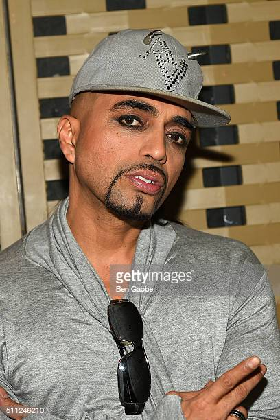 Fashion designer Adrian Alicea poses backstage at the Adrian Alicea fashion show during Fall 2016 New York Fashion Week at Mist Theater on February...