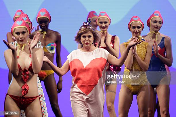 Fashion designer Agatha Ruiz de la Prada reacts during her show as part of MercedesBenz Fashion Week Mexico Spring/Summer 2017 at Sheraton Maria...