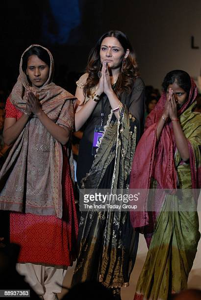 Fashion designer Agnimitra Paul along with Models are walking on the ramp with her outfit at Lakme Fashion Week Spring Summer2007 in Mumbai...