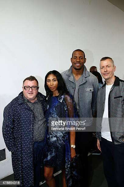 Fashion Designer Alber Elbaz, Guest, Basketball Player Andre Iguodala and Lanvin men fashion designer Lucas Ossendrijver pose Backstage prior the...