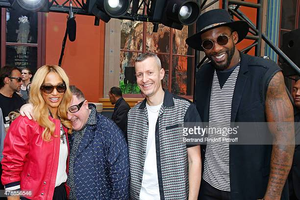 Fashion Designer Alber Elbaz Lanvin men fashion designer Lucas Ossendrijver and Basketball player Amar'e Stoudemire with his wife Alexis pose after...