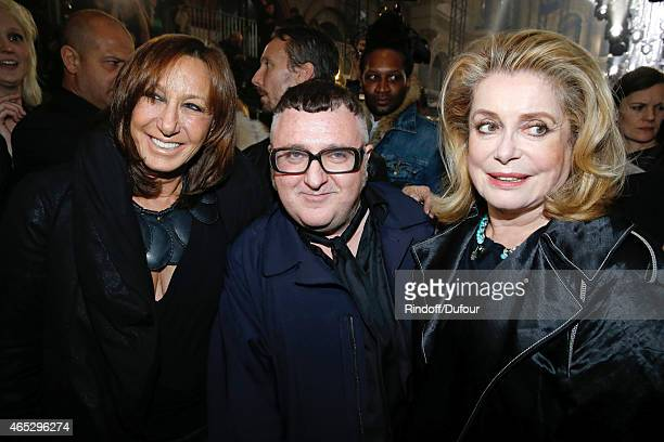 Fashion Designer Alber Elbaz pose between Catherine Deneuve and Donna Karan after the Lanvin show as part of the Paris Fashion Week Womenswear...