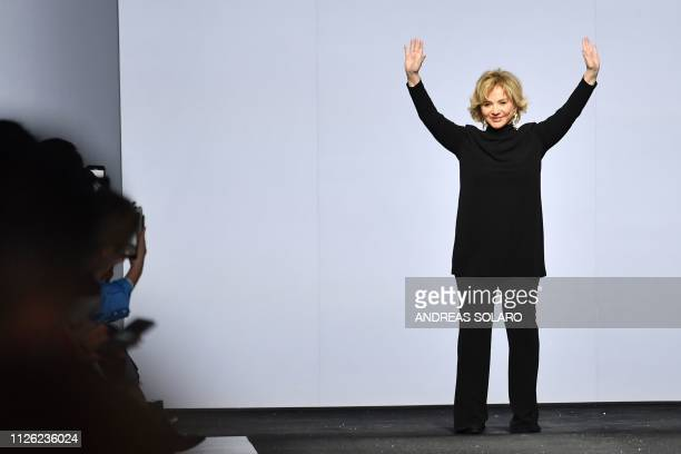 Fashion designer Alberta Ferretti acknowledges applause following the presentation of her women's Fall/Winter 2019/2020 collection on February 20...