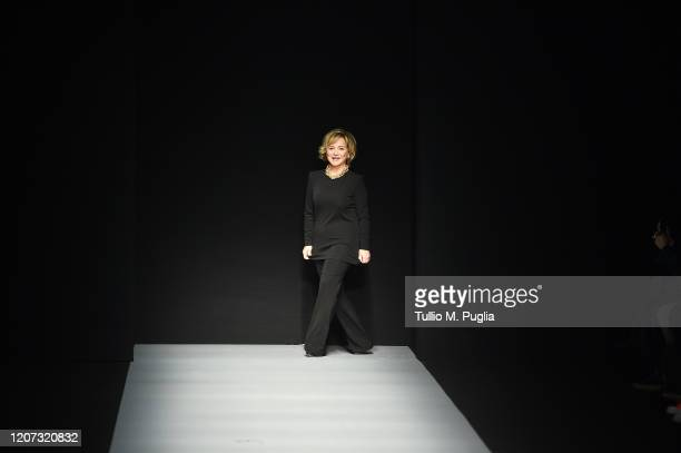 Fashion designer Alberta Ferretti acknowledges the applause of the audience during the Alberta Ferretti fashion show as part of Milan Fashion Week...