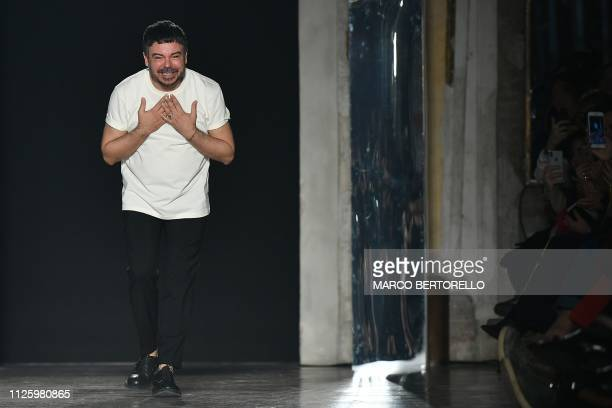 Fashion designer Alberto Zambelli acknowledges applause following his women's Fall/Winter 2019/2020 collection fashion show on February 20 2019 in...