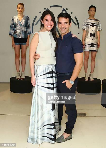 Fashion designer Alessandra Meskita and creative director Rapha Mendonca poses during Meskita - Presentaion - Spring 2016 New York Fashion Week on...