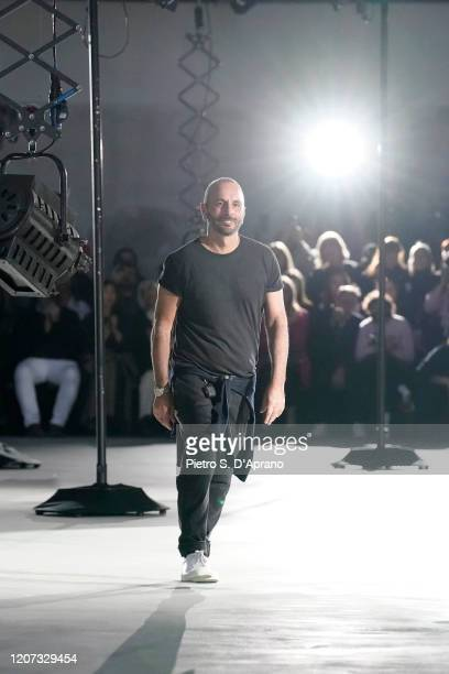 Fashion designer Alessandro Dell'Acqua acknowledges the applause of the audience during the N21 fashion show as part of Milan Fashion Week...
