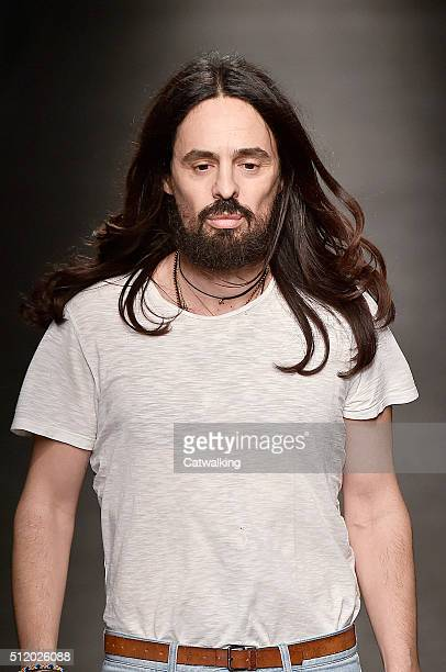 Fashion designer Alessandro Michele walks the runway at the Gucci Autumn Winter 2016 fashion show during Milan Fashion Week on February 24 2016 in...