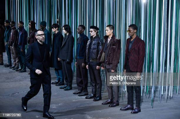 Fashion designer Alessandro Sartori walks the runway at the end of Ermenegildo Zegna fashion show on January 10 2020 in Milan Italy