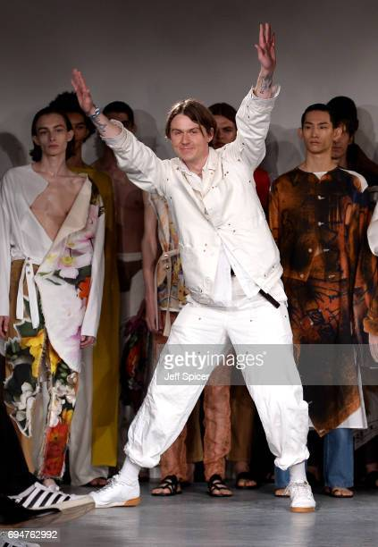 Fashion designer Alex Mullins and models on the runway after his show during the London Fashion Week Men's June 2017 collections on June 11 2017 in...